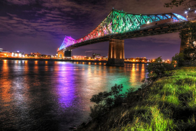 Colorful Jacques Cartier Bridge in Montreal City during Covid 19 - Royalty-Free Stock Imagery